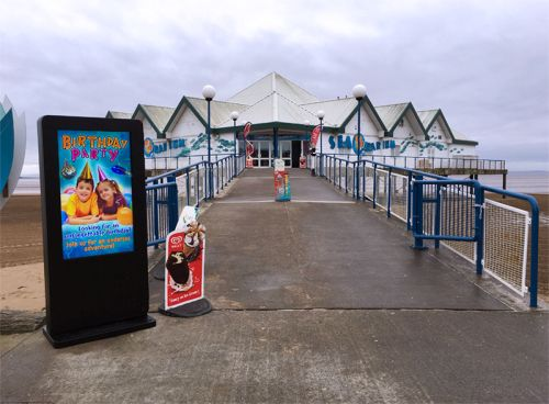 digital signage screens outdoor seaside beach aquarium